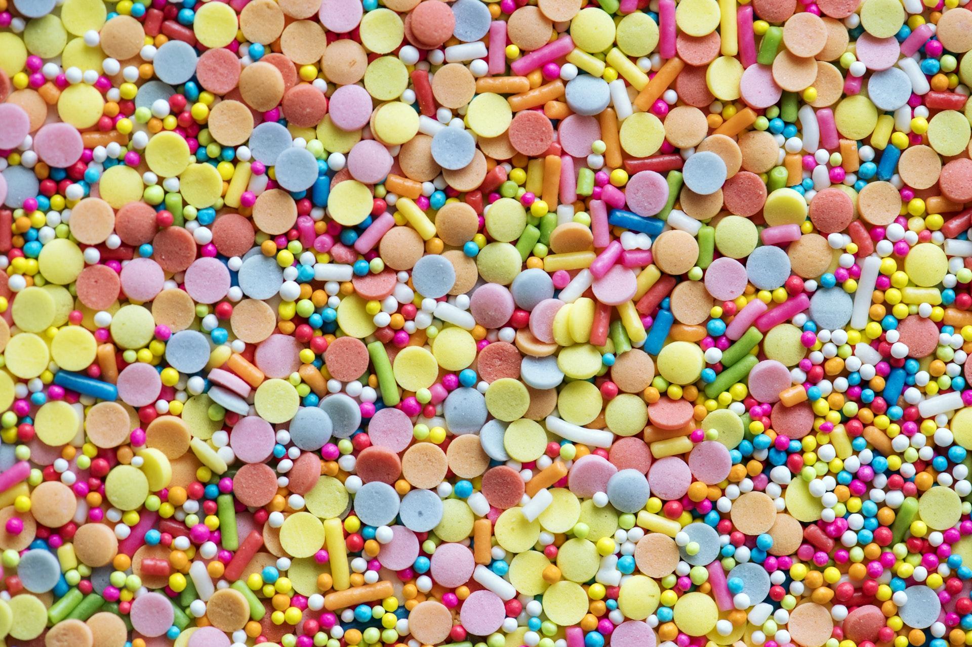 download wallpaper: snoepgoed in alle kleuren wallpaper